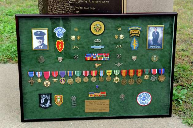 George Quamo's shadow box on Tuesday, Sept. 29, 2015, at Riverfront Park in Troy, N.Y. Dave Barnum and John Mullen, both of the Rensselaer County Vietnam Veterans Memorial Committee, are working a campaign to have Quamo, a Green Beret soldier from Averill Park, awarded a Medal of Honor. (Cindy Schultz / Times Union) Photo: Cindy Schultz / 00033511A