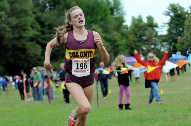 Colonie's Kathryn Tenney, center, comes in first to win the girls' Division II race during the Grout Invitational Cross Country Race on Saturday, Oct. 3, 2015, in Schenectady, N.Y. (Cindy Schultz / Times Union) Photo: Cindy Schultz / 10033573A