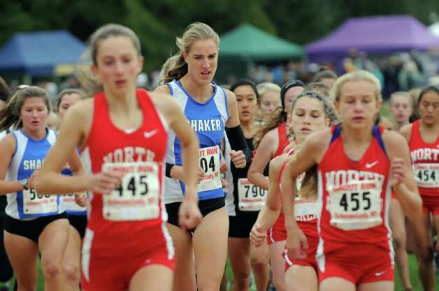 Shaker's Maryanna Lansing, center, begins the girls' Division I race behind North Rockland's Alex Harris (445), left, and Katelyn Tuohy (455), right, during the Grout Invitational Cross Country Race on Saturday, Oct. 3, 2015, in Schenectady, N.Y. Lansing came in third behind Harris and Tuohy, who took first and second, respectively. (Cindy Schultz / Times Union) Photo: Cindy Schultz / 10033573A