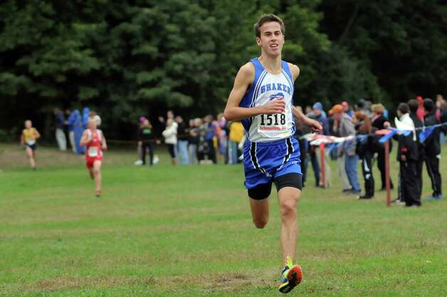 Shaker's Paul Nichols, right, takes first in the boys' Division I race during the Grout Invitational Cross Country Race on Saturday, Oct. 3, 2015, in Schenectady, N.Y. (Cindy Schultz / Times Union) Photo: Cindy Schultz / 10033573A