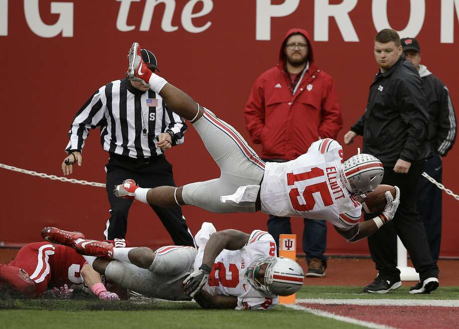 Ohio State's Ezekiel Elliott (15) dives into the end zone for a 55 yard for a touchdown run during the second half of an NCAA college football game against Indiana, Saturday, Oct. 3, 2015 in Bloomington, Ind. (AP Photo/Darron Cummings) Photo: Darron Cummings, Associated Press