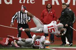Ohio State's Ezekiel Elliott (15) dives into the end zone for a 55 yard for a touchdown run during the second half of an NCAA college football game against Indiana, Saturday, Oct. 3, 2015 in Bloomington, Ind. (AP Photo/Darron Cummings)