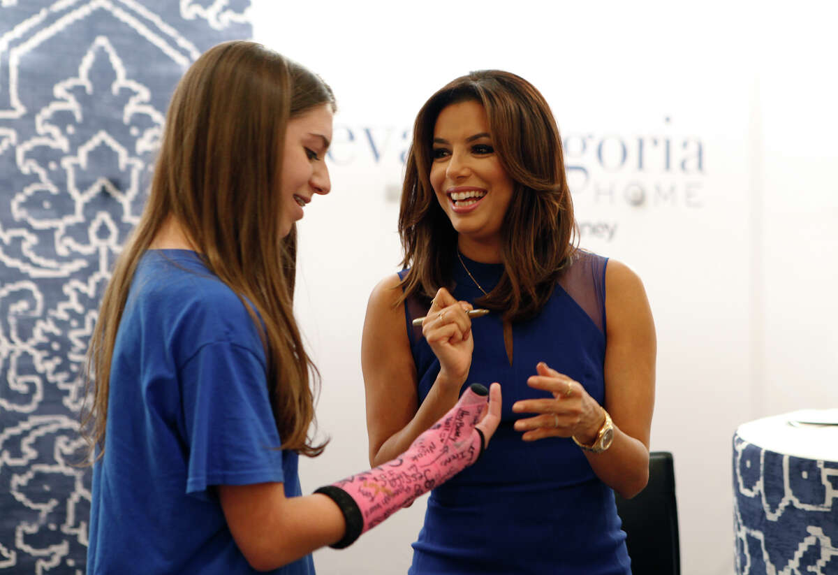 Eva Longoria signs Abigail Hawkins' cast at JCPenny Saturday Oct. 3, 2015 inside North Star Mall while promoting her new Eva Longoria Home Collection which includes bedding, decorative pillows and window treatments. JCPenny had 125 wristbands for those who wanted to see Longoria in the store and were handed out that day to those who first showed for the hour long autograph session, which Hawkins almost did not get. A person in in line gave up their wristband to allow Hawkins the opportunity to meet the actress.