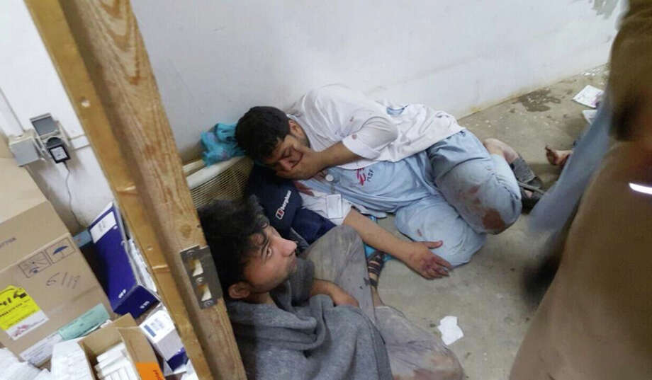 "Injured Doctors Without Borders staff are seen after explosions near their hospital in the northern Afghan city of Kunduz, Saturday, Oct. 3, 2015. Doctors Without Borders announced that the death toll from the bombing of the group's Kunduz hospital compound has risen to at least 16, including 3 children and that tens are missing after the explosions that may have been caused by a U.S. airstrike. In a statement, the international charity said the ""sustained bombing"" took place at 2:10 a.m. (21:40 GMT). Afghan forces backed by U.S. airstrikes have been fighting to dislodge Taliban insurgents who overran Kunduz on Monday. (Médecins Sans Frontieres via AP) ORG XMIT: CAIBS102 Photo: Uncredited / Médecins Sans Frontières"