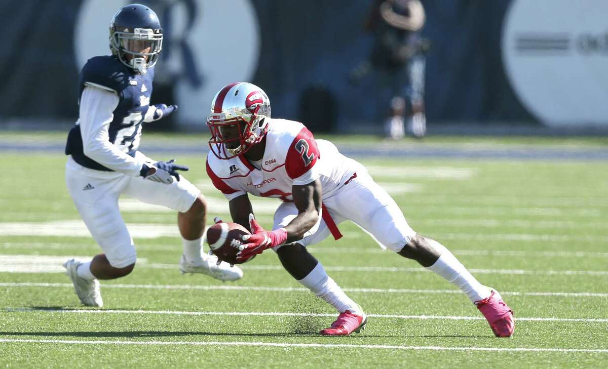 WKU receiver Taywan Taylor (2) catches the ball for a first down. Photos of Rice University football game against Western Kentucky University at Rice Stadium on Saturday, Oct. 3, 2015, in Houston.