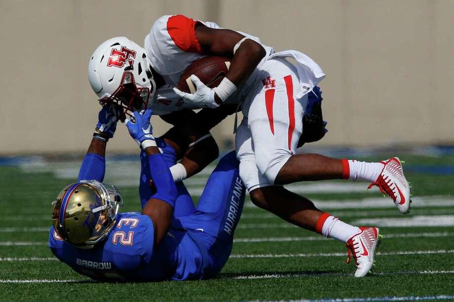 Stopping Greg Ward Jr. was no easy task, as he rushed for 182 yards on Saturday, so Tulsa's Will Barrow resorts to grabbing Ward's facemask. Photo: Tom Gilbert, MBI / Tulsa World