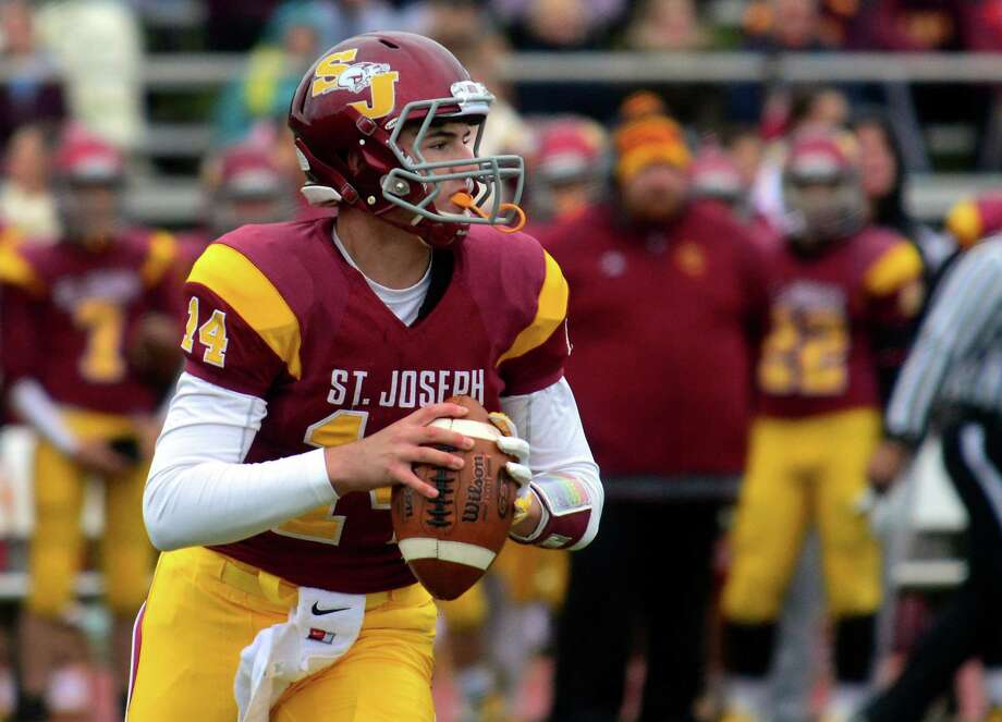 St. Joseph QB Timothy Lombardi during high school football action against Danbury in Trumbull, Conn. on Saturday October 3, 2015. Photo: Christian Abraham / Hearst Connecticut Media / Connecticut Post