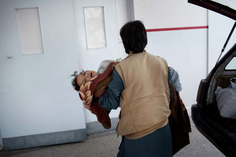 Madina, an eight year old who was at the Doctors Without Borders hospital hit by a United States airstrike in Kunduz, is carried into the emergency room of another hospital in Kabul, Afghanistan, Oct. 3, 2015. At least 19 people died and dozens more were wounded at the Kunduz hospital run by the aid group widely known as Medecins Sans Frontieres. (Victor J. Blue/The New York Times) Photo: VICTOR J. BLUE, STR / New York Times / NYTNS