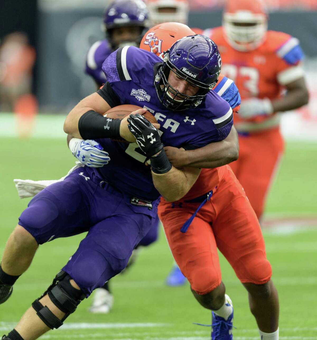 Zach Conquer (2) of the Stephen F. Austin Lumberjacks is brought down after making a short run in the first half against the Sam Houston State Bearkats during the 90th Battle Of The Piney Woods on Saturday, October 3, 2015 at NRG Stadium.