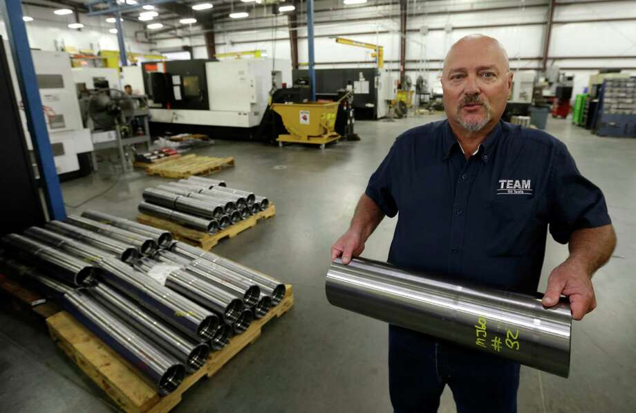Perry Phillips, plant manager for Team Oil Tools in Conroe, talks about the downhole tools the company makes there for the oil industry.  Phillips relocated from Tulsa, Oklahoma after the company closed its plant there.  ( Melissa Phillip  /  Houston Chronicle ) Photo: Melissa Phillip, Staff / © 2015 Houston Chronicle