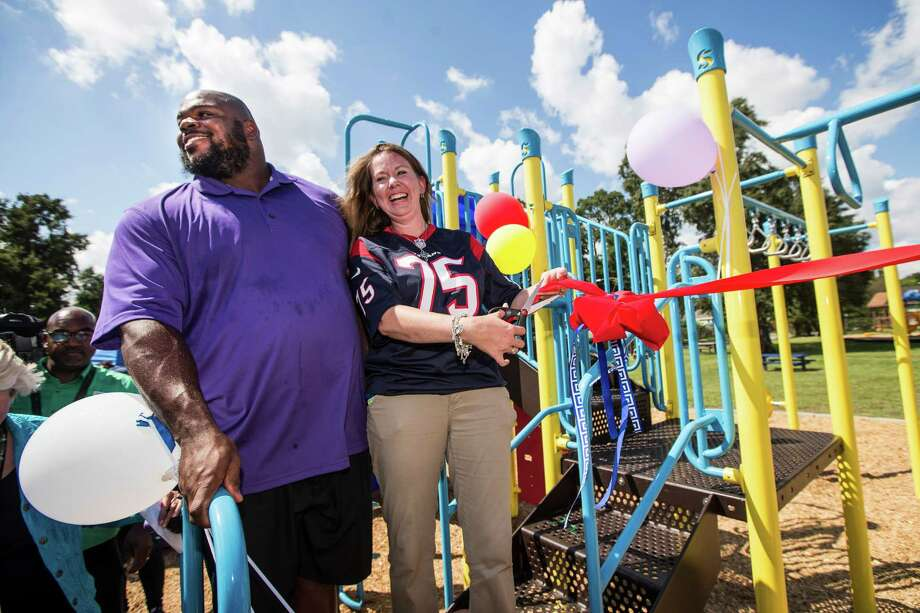 Houston Texans nose tackle Vince Wilfork, left, stands with Looscan Elementary School Principal Erin Chavez as they cut the ribbon on new playground equipment at the school's SPARK park in 2015.  Photo: Brett Coomer, Houston Chronicle / © 2015 Houston Chronicle
