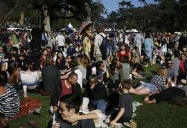 People lounge during the annual Hardly Strictly Bluegrass Festival in Golden Gate park Oct. 3, 2015 in San Francisco, Calif.