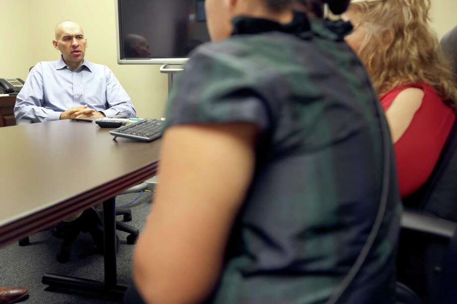 Women who say they were ripped off by former immigration lawyer Paul Esquivel meet in the office of attorney David Armendáriz to talk about their experiences. Photo: William Luther / San Antonio Express-News / © 2015 San Antonio Express-News