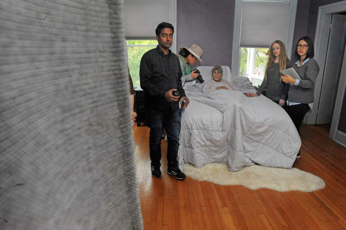 """Director Dharius Zulkefli, center, blocks a scene for the film """"Fado,"""" an independent film about a man with Alzheimer's, on Saturday Oct. 3, 2015 in troy , N.Y. (Michael P. Farrell/Times Union)"""