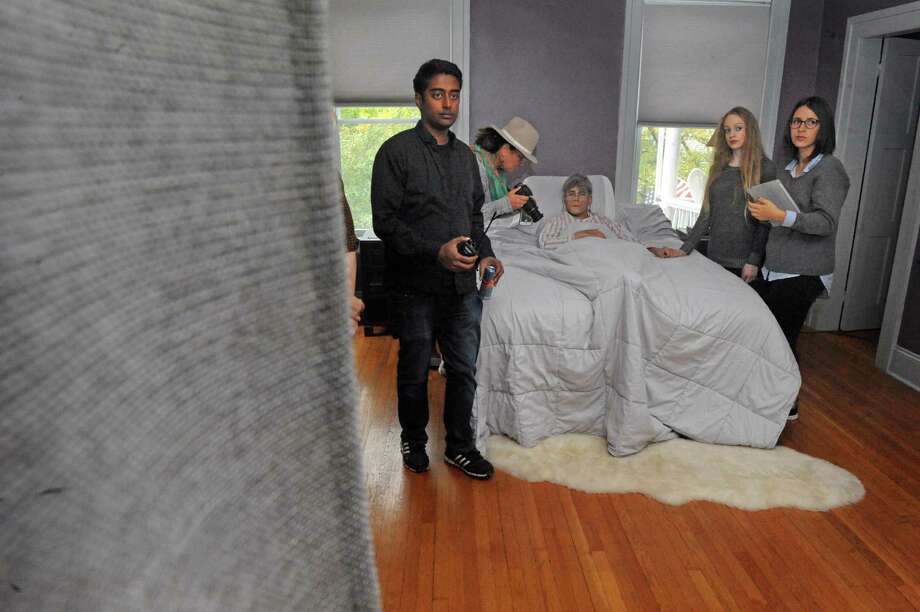"Director Dharius Zulkefli, center, blocks a scene for the film ""Fado,"" an independent film about a man with Alzheimer's, on Saturday Oct. 3, 2015 in troy , N.Y.  (Michael P. Farrell/Times Union) Photo: Michael P. Farrell / 10033603A"