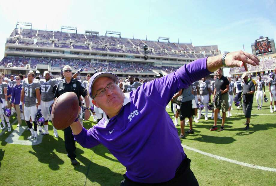 FORT WORTH, TX - OCTOBER 03:  Head coach Gary Patterson of the TCU Horned Frogs throws a game ball into the stands after the Horned Frogs beat the Texas Longhorns 50-7 at Amon G. Carter Stadium on October 3, 2015 in Fort Worth, Texas.  (Photo by Tom Pennington/Getty Images) Photo: Tom Pennington, Staff / Getty Images / 2015 Getty Images