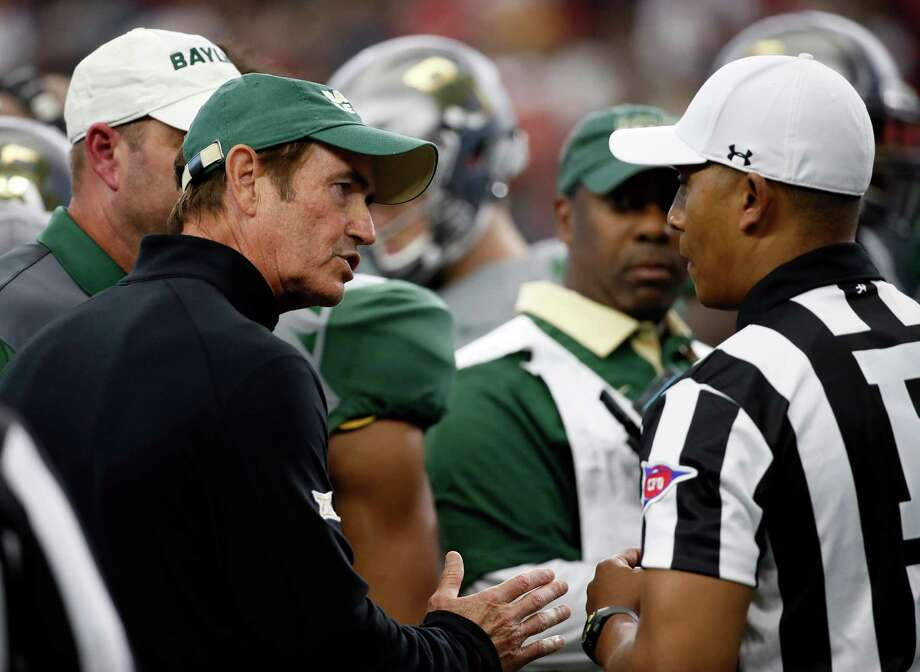 Baylor head coach Art Briles, left, talks with officials during a time out in the first half of an NCAA college football game against Texas Tech Saturday, Oct. 3, 2015, in Arlington, Texas. (AP Photo/Tony Gutierrez) Photo: Tony Gutierrez, Associated Press / AP