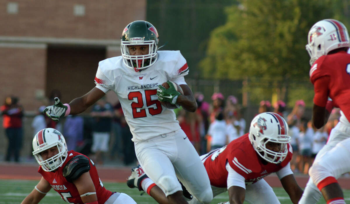 The Woodlands junior running back Jordan Talford (25) runs thru the Atascocita defense during first quarter action of their District 16-6A matchup at Turner Stadium in Humble on Saturday, Oct. 3, 2015. (Photo by Jerry Baker/Freelance)