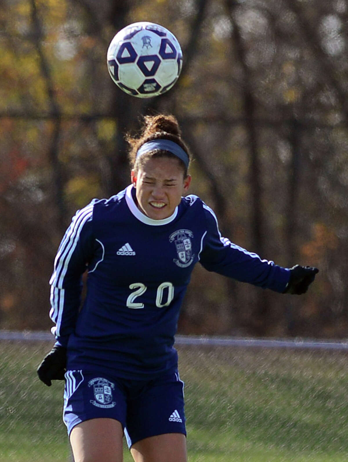 FILE PHOTO: Immaculate's Mackenzie Mitchell heads the ball, during Class L CIAC state girls soccer championship action against Avon in West Haven, Conn. on Saturday Nov. 15, 2014. Immaculate No. 20 MacKenzie Mitchell Jr.