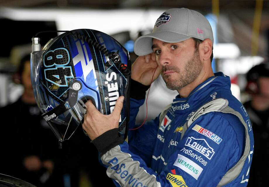 Jimmie Johnson gets ready before practice for the NASCAR Sprint Cup series auto race, Saturday, Oct. 3, 2015, at Dover International Speedway in Dover, Del. (AP Photo/Nick Wass) ORG XMIT: DOV106 Photo: Nick Wass / FR67404 AP