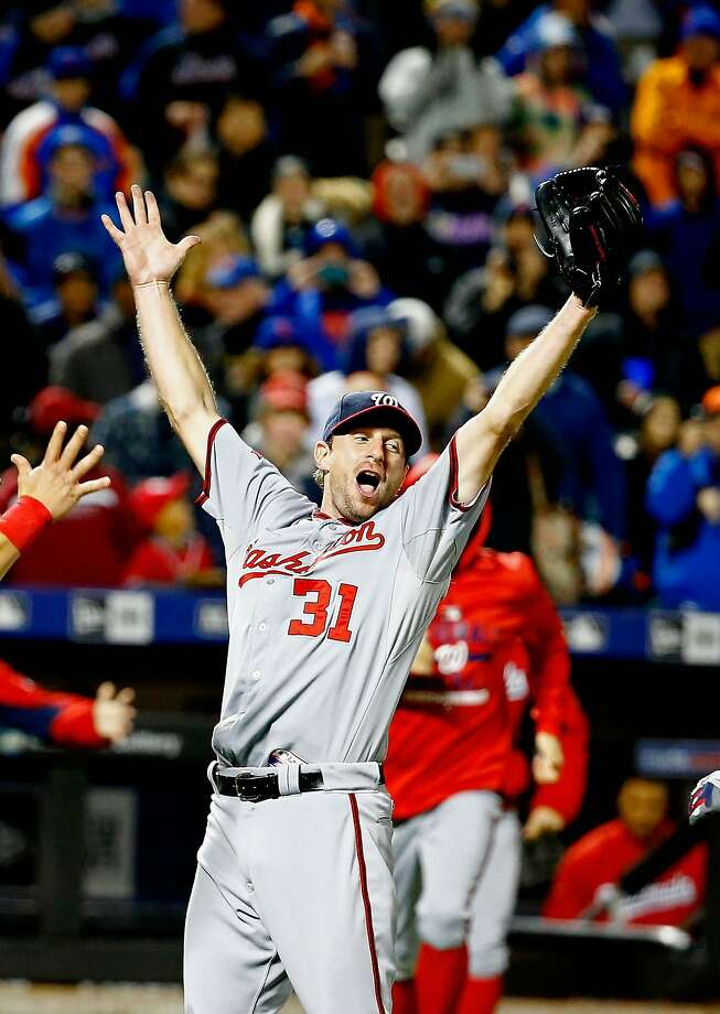 It never gets old: Nationals pitcher Max Scherzer raises his arms in triumph after his second no-hitter of 2015. Photo: Al Bello, Getty Images