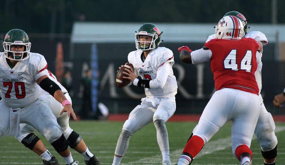 The Woodlands junior quarterback Eric Schmid, center, works for a receiver behind junior offensive lineman Hunter Madore (70) against Atascocita junior defensive lineman Demarius Brooks (44) during second quarter action of their District 16-6A matchup at Turner Stadium in Humble on Saturday, Oct. 3, 2015. (Photo by Jerry Baker/Freelance) Photo: Jerry Baker, For The Houston Chronicle