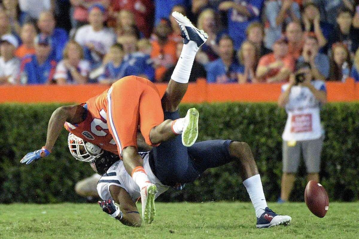 Florida defensive back Keanu Neal, above, dislodges a pass intended for Mississippi wide receiver Quincy Adeboyejo during the second half of an NCAA college football game Saturday, Oct. 3, 2015, in Gainesville, Fla. (AP Photo/Phelan M. Ebenhack)
