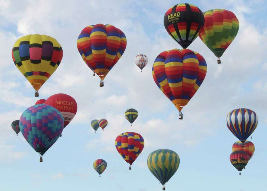 Hundreds of balloons lifted off Saturday morning to mark the official start of the 44th annual Albuquerque International Balloon Fiesta. Photo: Susan Montoya Bryan, STF / AP