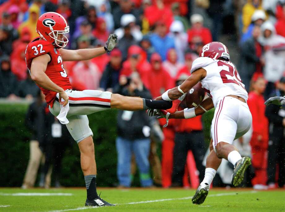 Alabama's domination of Georgia included Minkah Fitzpatrick, right, blocking a punt by Collin Barber and recovering it for a second-quarter touchdown. Photo: Kevin C. Cox, Staff / 2015 Getty Images