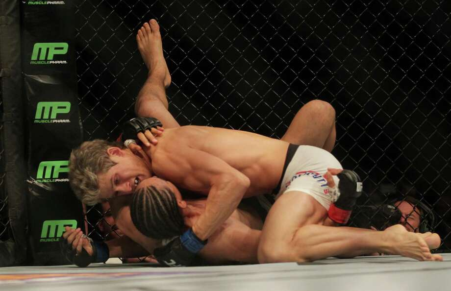 Sage Northcutt grapples with Francisco Trevino during UFC 192 at the Toyota Center Saturday, Oct. 3, 2015, in Houston. Northcutt won the match with a TKO in 57 seconds. ( Jon Shapley / Houston Chronicle ) Photo: Jon Shapley, Staff / © 2015  Houston Chronicle