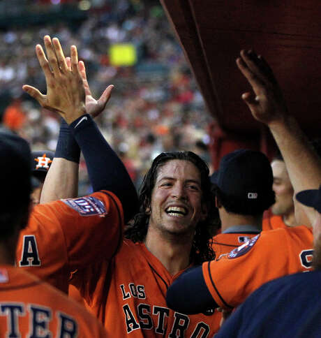 Outfielder Colby Rasmus was the center of attention after blasting a pair of home runs to help the Astros stay a game ahead of the Angels in the race for the second wild card Saturday night. Photo: Karen Warren, Staff / © 2015 Houston Chronicle