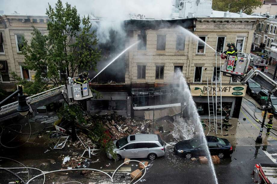 Firefighters work on the scene of a fatal explosion in Brooklyn, N.Y. A gas leak was suspected by authorities to be the cause. In addition to the fatality, three people were injured. Photo: Robert Stolarik / New York Times / NYTNS