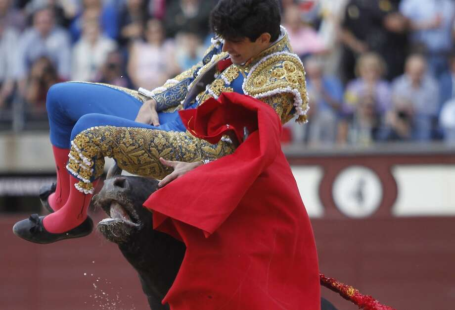 Spanish matador Alberto Lopez Simon is thrown in the air after being gored by a bull during the Otono Feria at Las Ventas bullring in Madrid on October 2, 2015. Photo: Alberto Simon, AFP / Getty Images