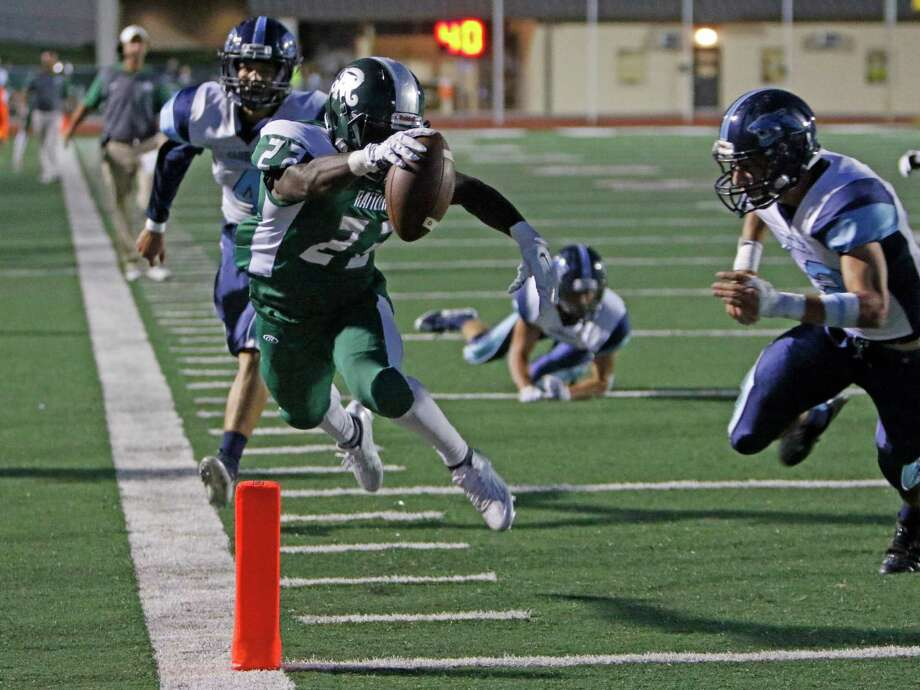 Reagan Marquis Duncan dives into the end zone for his 2nd quarter TD. District 26-6A high school football game between Reagan and Johnson at Comalander Stadium on Saturday, October 3, 2015. Photo: Ron Cortes, Freelance / For The San Antonio