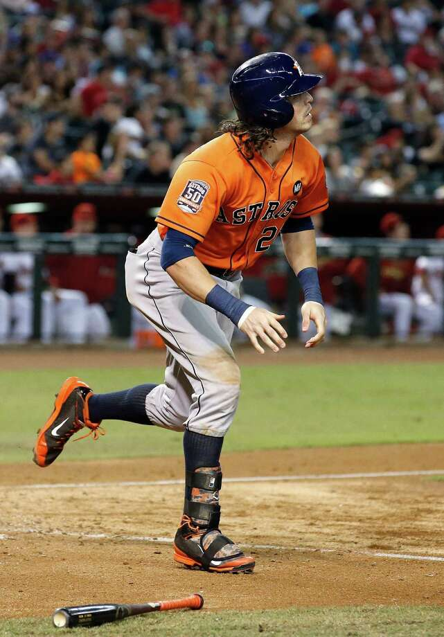 Houston Astros' Colby Rasmus watches his two-run home run ball clear the fence against the Arizona Diamondbacks during the sixth inning of a baseball game Friday, Oct. 2, 2015, in Phoenix. (AP Photo/Ross D. Franklin) ORG XMIT: PNC115 Photo: Ross D. Franklin / AP