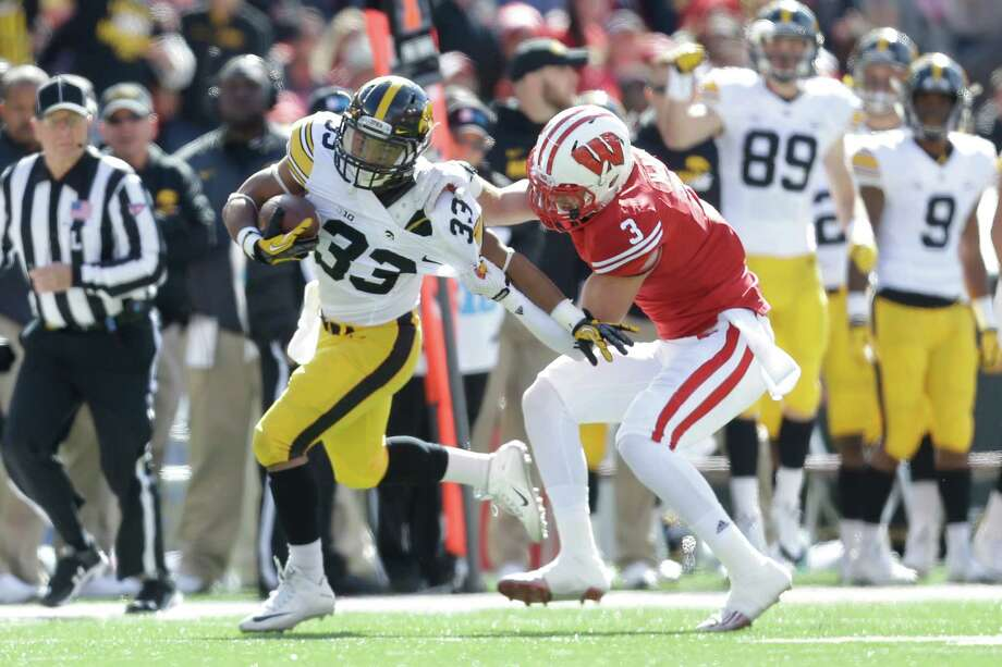MADISON, WI - OCTOBER 03: Jordan Canzeri #33 of the Iowa Hawkeyes runs with the football during the first half against the Wisconsin Badgers at Camp Randall Stadium on October 03, 2015 in Madison, Wisconsin. (Photo by Mike McGinnis/Getty Images) ORG XMIT: 579517795 Photo: Mike McGinnis / 2015 Getty Images