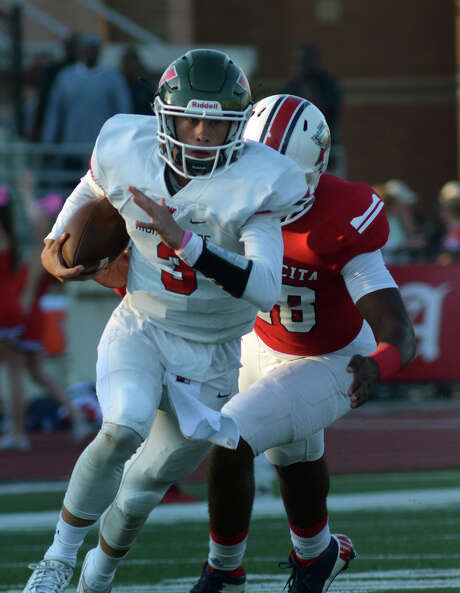 The Woodlands junior quarterback Eric Schmid (3) outruns Atascocita senior linebacker Andre Mickles Jr. during 1st quarter action of their District 16-6A matchup at Turner Stadium in Humble on Saturday, Oct. 3, 2015. (Photo by Jerry Baker/Freelance) Photo: Jerry Baker, Freelance