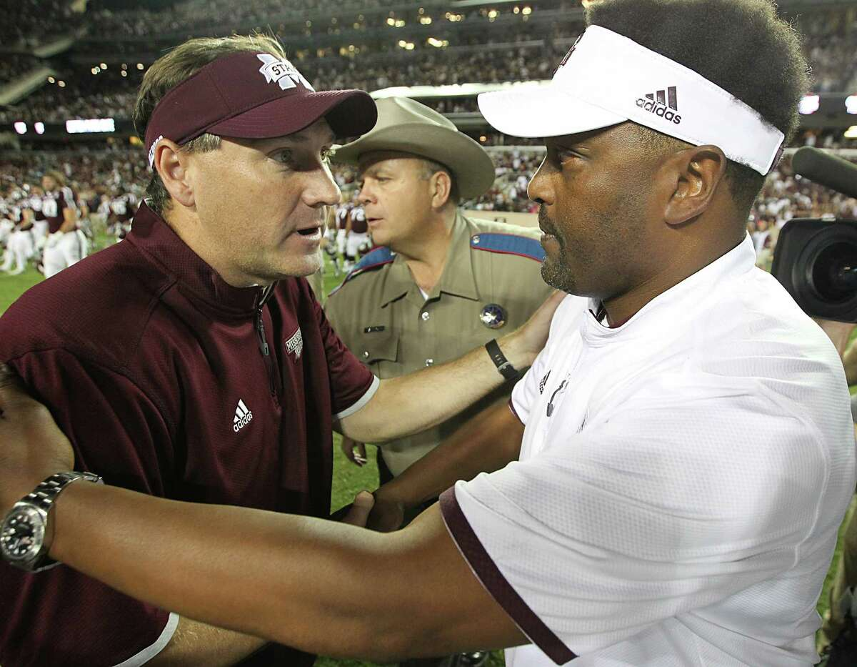 COLLEGE STATION, TX - OCTOBER 03: Head coach Dan Mullen of the Mississippi State Bulldogs shakes hands with head coach Kevin Sumlin of the Texas A&M Aggies after the game on October 3, 2015 at Kyle Field in College Station, Texas. Aggies won 30 to 17.