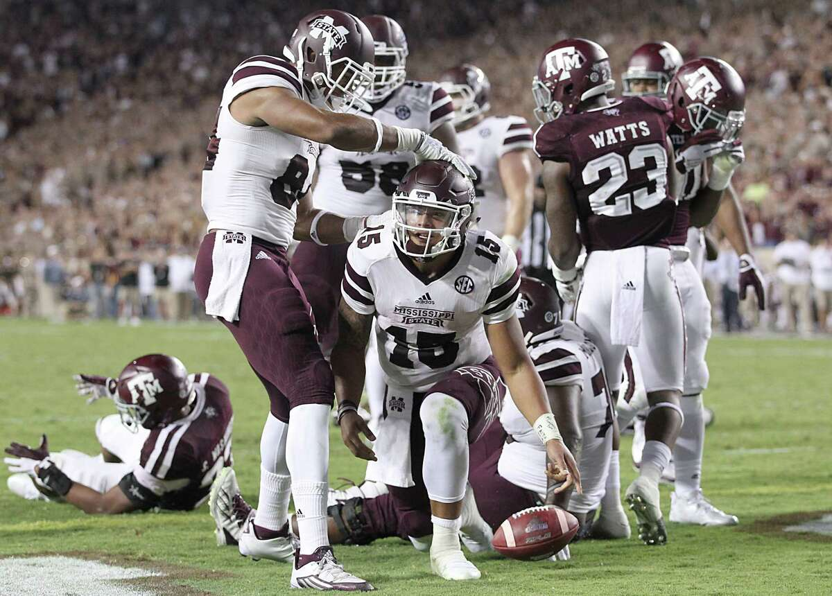 COLLEGE STATION, TX - OCTOBER 03: Dak Prescott #15 of the Mississippi State Bulldogs is congratulated y teammates after rushing for a touchdown against the Texas A&M Aggies in the fourth quarter on October 3, 2015 at Kyle Field in College Station, Texas. Aggies won 30 to 17.