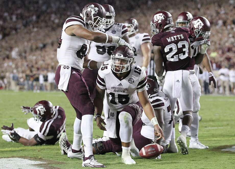 COLLEGE STATION, TX - OCTOBER 03: Dak Prescott #15 of the Mississippi State Bulldogs is congratulated  y teammates after rushing for a touchdown against the Texas A&M Aggies in the fourth quarter on October 3, 2015 at Kyle Field in College Station, Texas. Aggies won 30 to 17. Photo: Thomas B. Shea, Getty Images / 2015 Getty Images