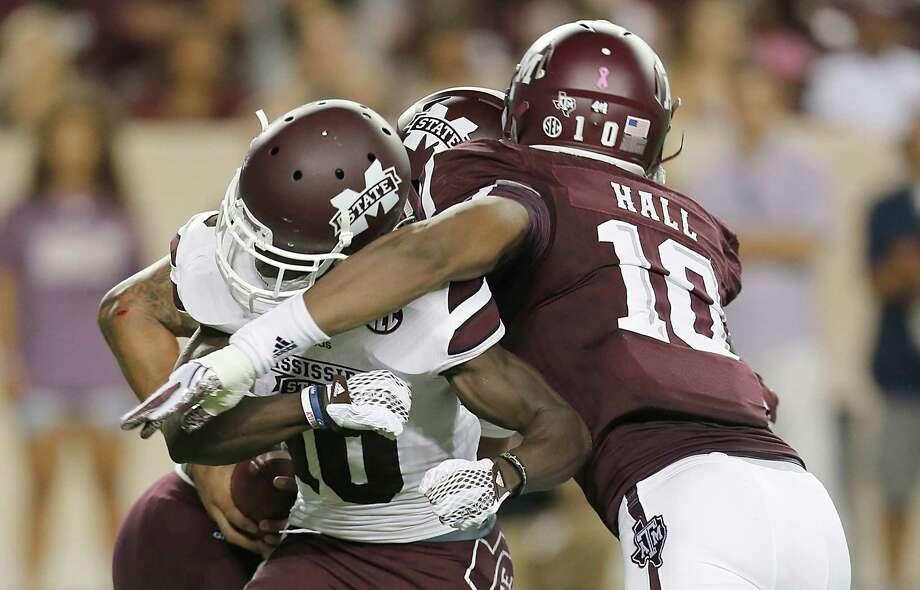 COLLEGE STATION, TX - OCTOBER 03: Daeshon Hall #10 of the Texas A&M Aggies runs over Brandon Holloway #10 of the Mississippi State Bulldogs to tackle Dak Prescott #15 in the second quarter on October 3, 2015 at Kyle Field in College Station, Texas. (Photo by Thomas B. Shea/Getty Images) Photo: Thomas B. Shea, Stringer / Getty Images / 2015 Getty Images