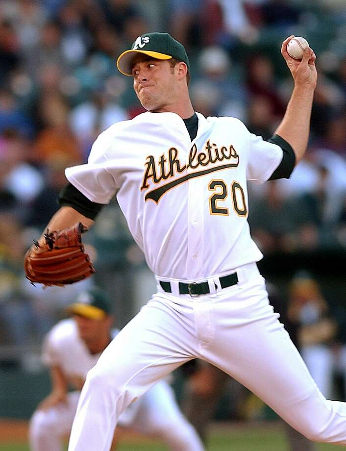 "In this file photo from Friday, June 28, 2002, Oakland Athletics' Mark Mulder works against the San Francisco Giants in Oakland, Calif. A's Barry Zito will have one last start in an A's uniform on Saturday, Sept. 26, 2015. Opposing the A's left-hander will be the San Francisco Giants' Tim Hudson, who along with Zito and Mark Mulder were part of the A's ""Big Three'' from 2000-04. (AP Photo/Ben Margot) Photo: Ben Margot, Associated Press"
