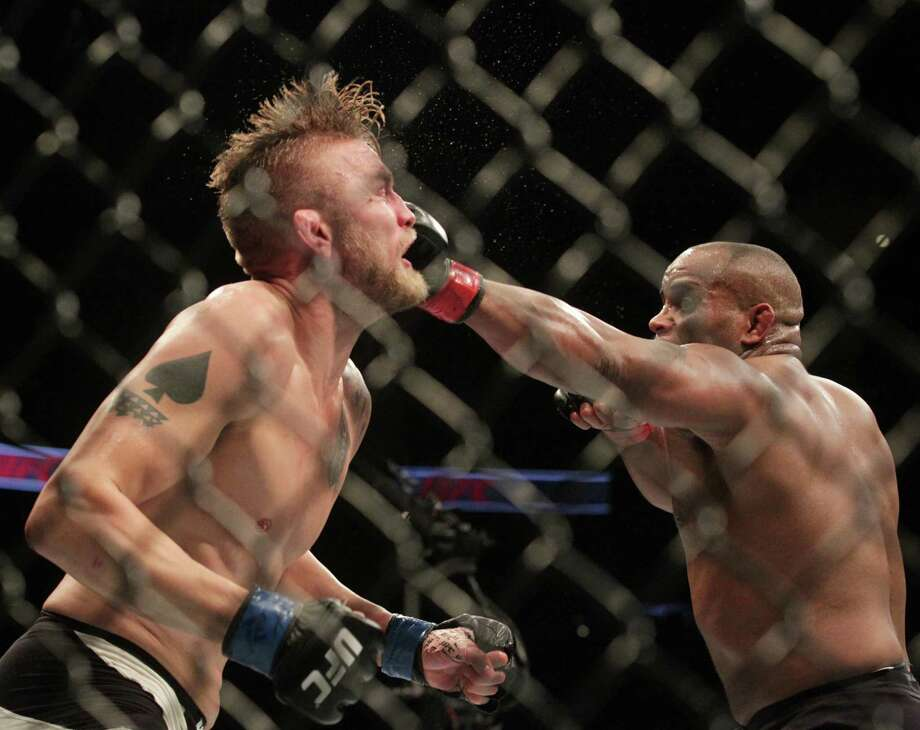 Daniel Cormier lands a punch against Alexander Gustafsson during their world light heavyweight championship match during UFC 192 at the Toyota Center Saturday, Oct. 3, 2015, in Houston. Cormier won the match by decision.Click through the gallery for more photos from UFC 192. Photo: Jon Shapley, Houston Chronicle / © 2015  Houston Chronicle