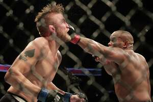 Daniel Cormier outlasts Alexander Gustafsson to retain UFC light heavyweight title - Photo