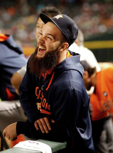A day after winning his 20th game of the season, Astros pitcher Dallas Keuchel was enjoying himself as he watched his teammates win 6-2 on Saturday. Photo: Karen Warren, Staff / © 2015 Houston Chronicle