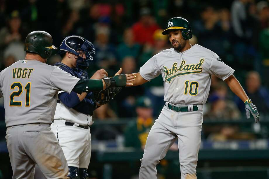 SEATTLE, WA - OCTOBER 03:  Marcus Semien #10 of the Oakland Athletics is congratulated by Stephen Vogt #21 after hitting a two-run home run against the Seattle Mariners in the thirteenth inning at Safeco Field on October 3, 2015 in Seattle, Washington.  (Photo by Otto Greule Jr/Getty Images) Photo: Otto Greule Jr, Getty Images