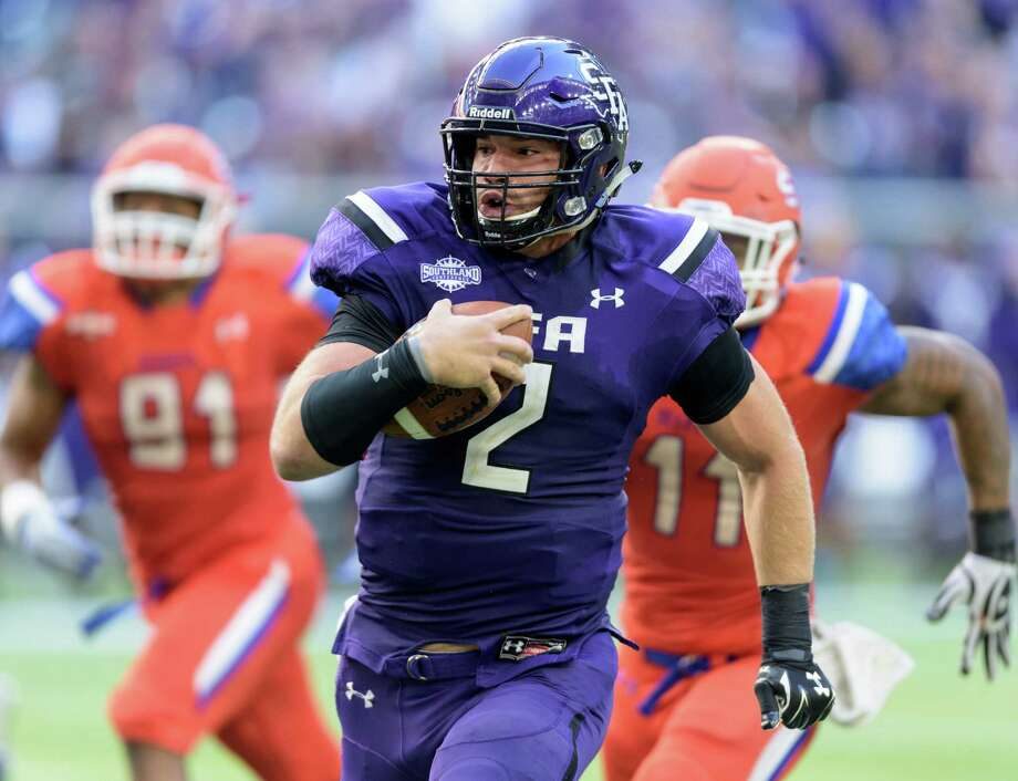 Zach Conque (2) of the Stephen F. Austin Lumberjacks runs around the left end in the first half against the Sam Houston State Bearkats during the 90th Battle Of The Piney Woods on Saturday, October 3, 2015 at NRG Stadium. Photo: Wilf Thorne, For The Chronicle / © 2015 Houston Chronicle