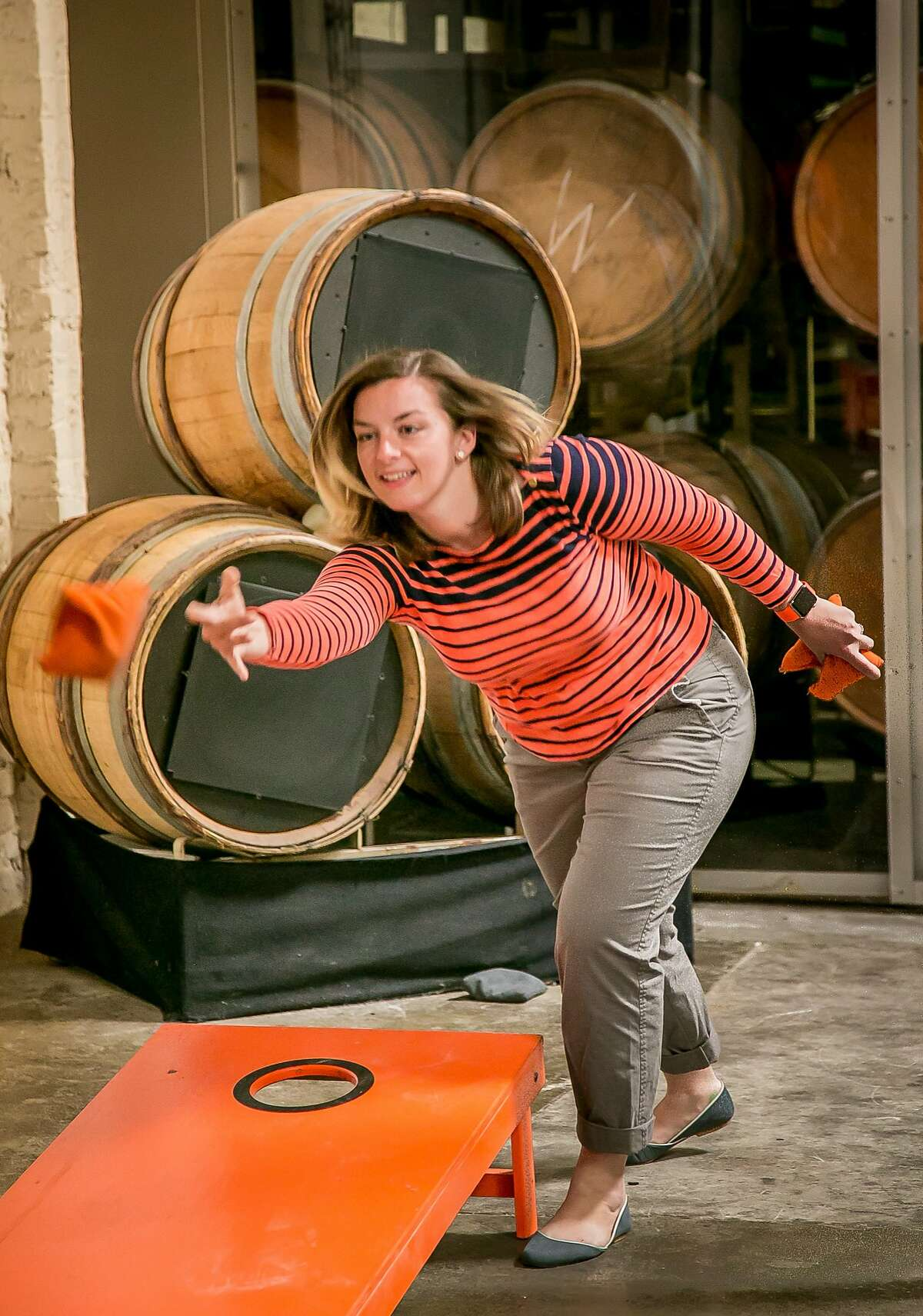 Dia Joyce plays with bean bags at at Bluxome Street Winery in San Francisco, Calif. on Saturday, October 3rd, 2015.