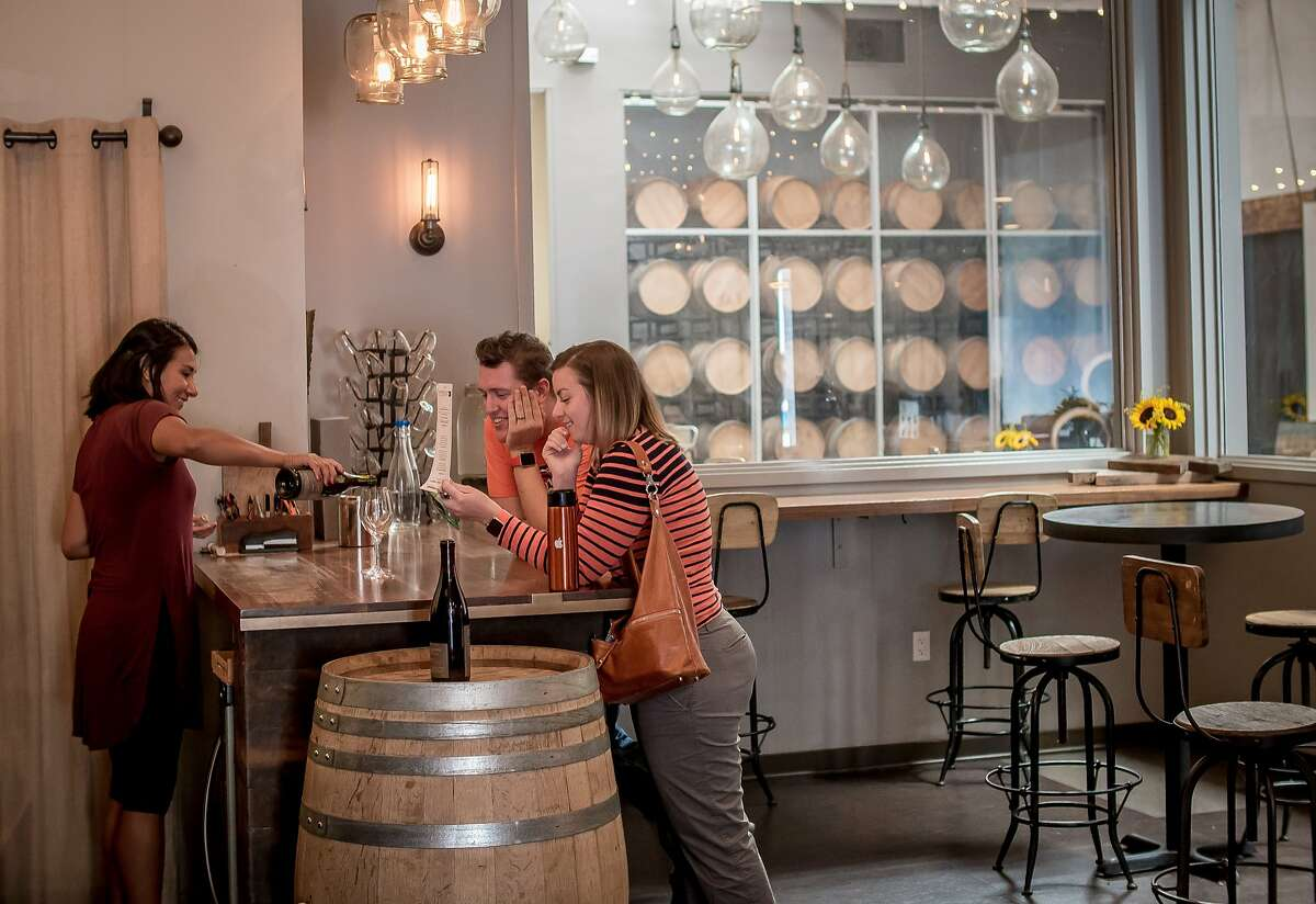 Melissa Lizarraga pours wine for Daniel and Dia Joyce at Bluxome Street Winery in San Francisco, Calif. on Saturday, October 3rd, 2015.