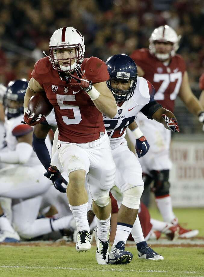Stanford's Christian McCaffrey (5) runs past Arizona safety Anthony Lopez (28) during the second half of an NCAA college football game Saturday, Oct. 3, 2015, in Stanford, Calif.  (AP Photo/Marcio Jose Sanchez) Photo: Marcio Jose Sanchez, Associated Press